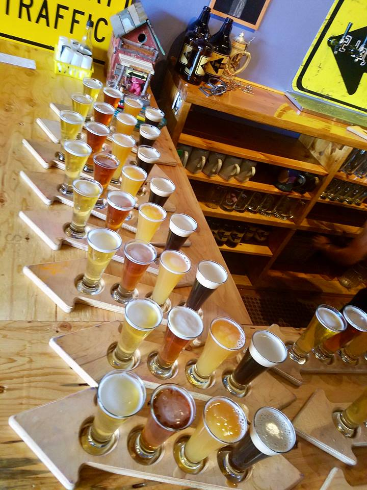 Many beers in glasses on display